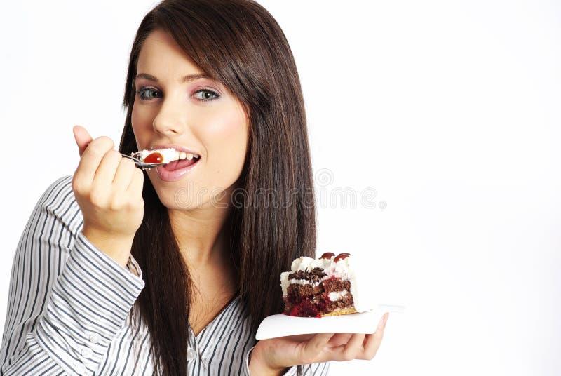 gâteau mangeant la femme de partie image stock