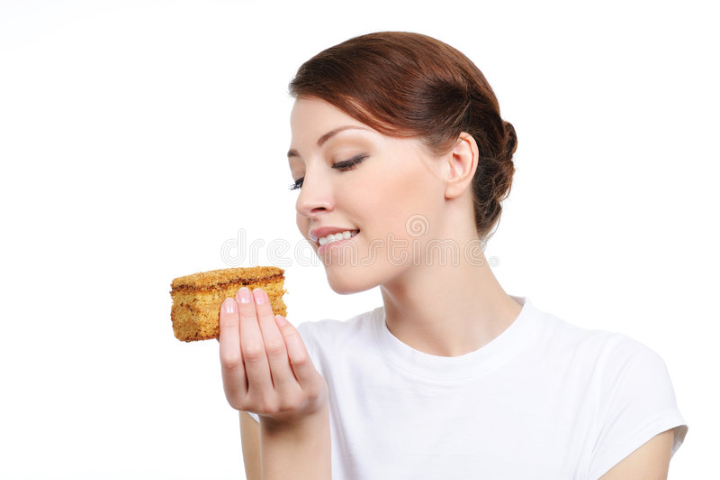 gâteau mangeant la femme de tentation photo stock