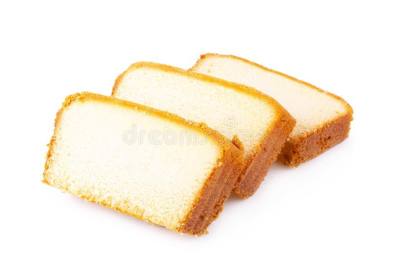 Gâteau moite découpé en tranches de beurre d'isolement sur le fond blanc image stock