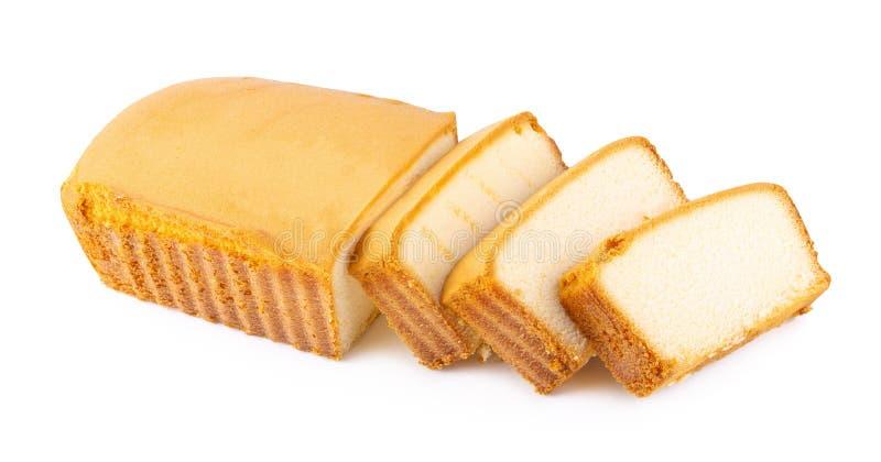 Gâteau moite découpé en tranches de beurre d'isolement sur le fond blanc photos libres de droits