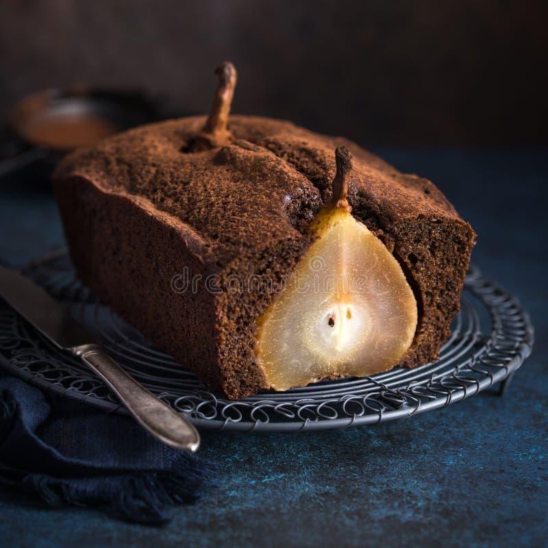 Gâteau poché de gingembre de poire images libres de droits