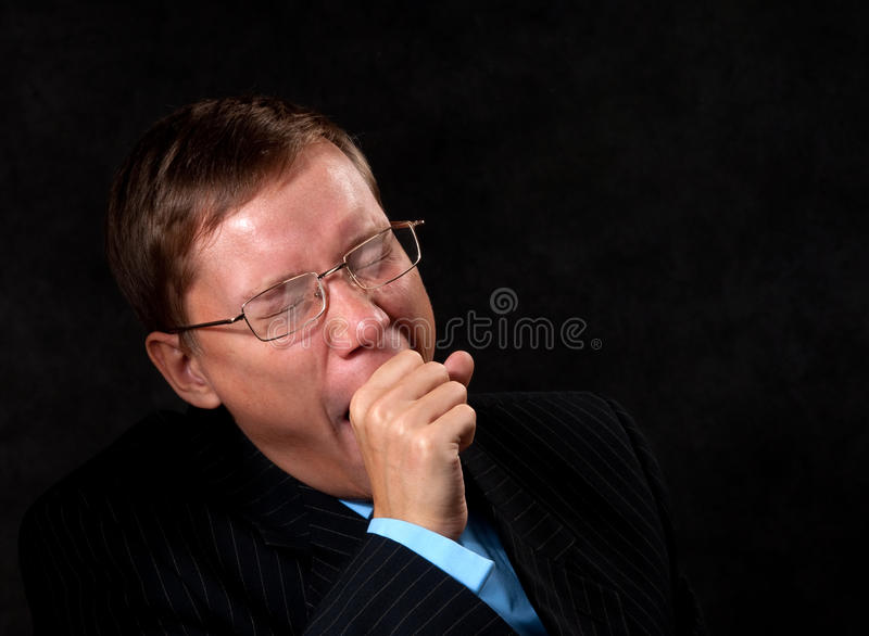 Gähnender Geschäftsmann stockbilder