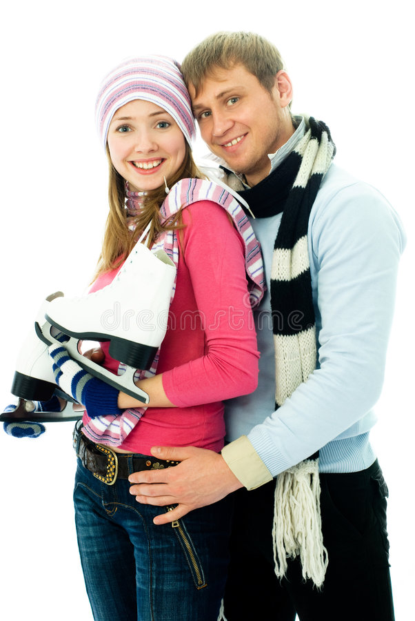 gående lyckligt skridskoåkningbarn för par arkivfoto