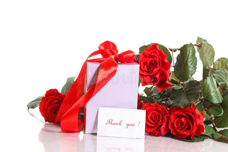 Gåva med blommor och tacksamhet arkivbild