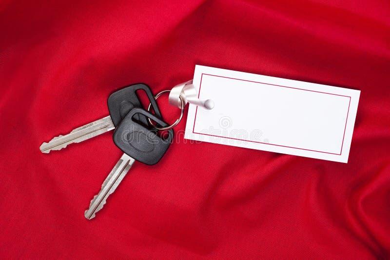 gåvan för bilkortet keys red arkivfoto