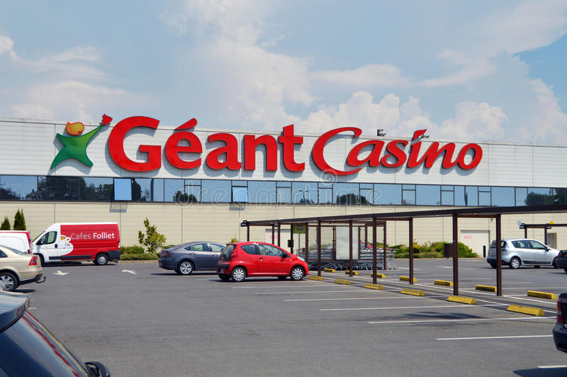 Géant Casino hypermarket. SEDAN, FRANCE - JULY 2013: Facade and parking of a Géant Casino hypermarket, part of French retailing giant Groupe stock photography