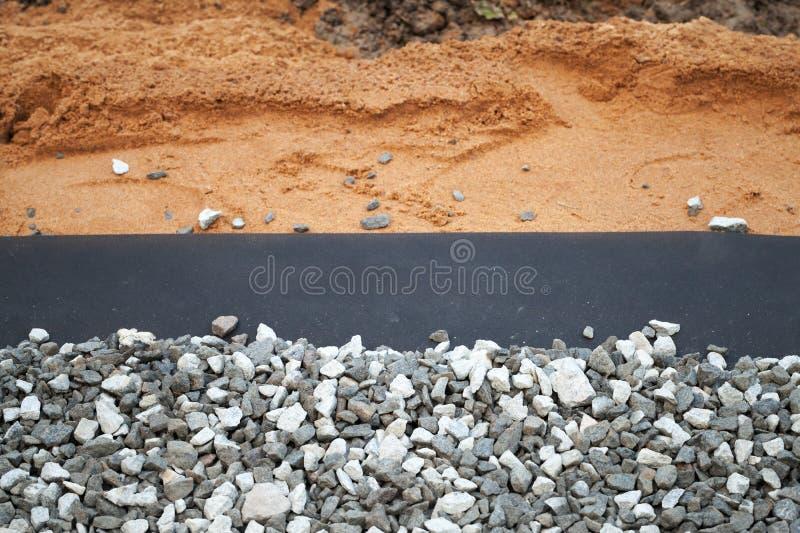 g otextile avec le gravier gris photo stock image 33236902. Black Bedroom Furniture Sets. Home Design Ideas