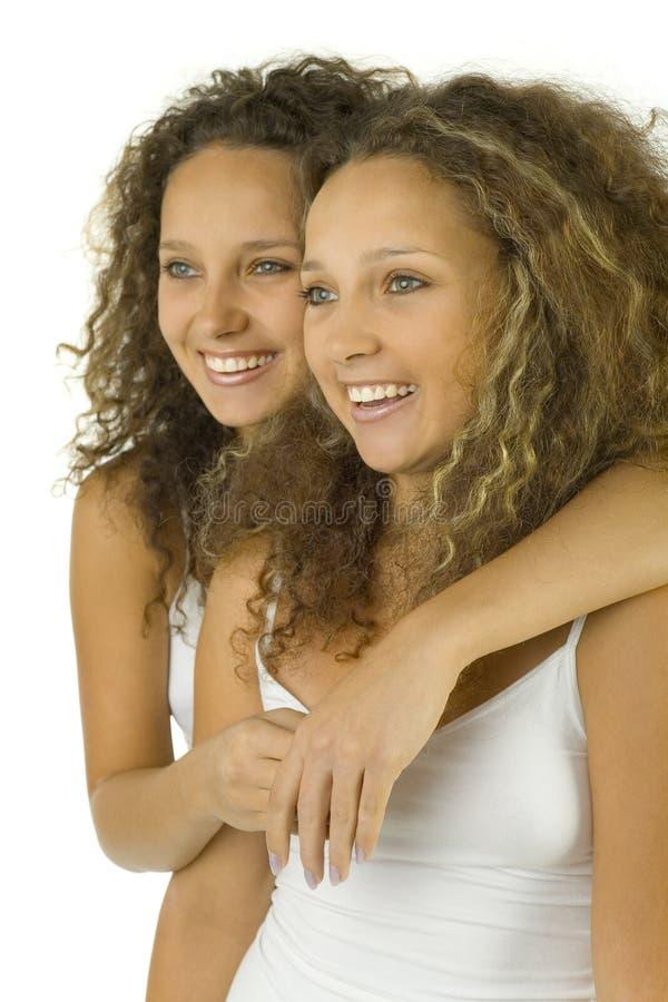 Gêmeos no abraço imagens de stock