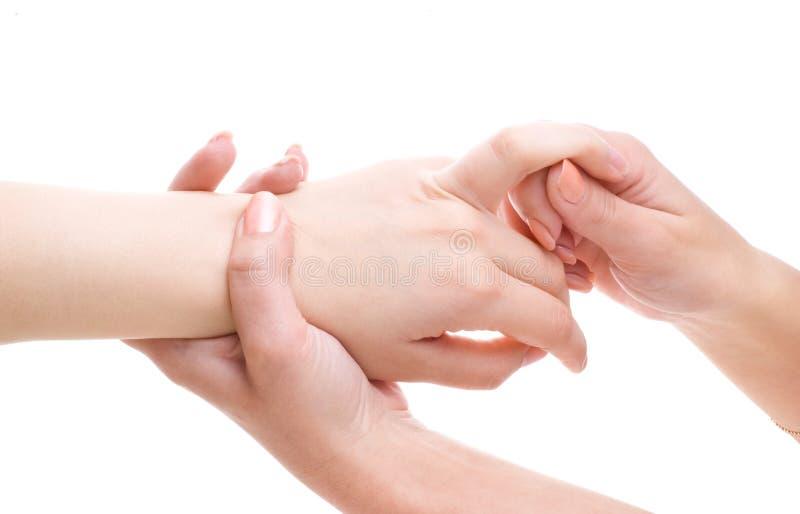 Gömma i handflatan massagen fotografering för bildbyråer