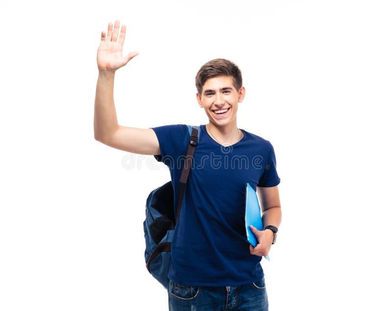 Gör en gest den hållande mapp- och visninghälsningen för manlig student arkivfoton