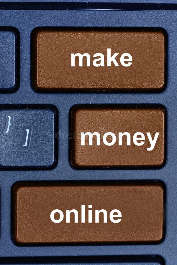Gör pengar online-ord på datortangentbordet royaltyfria bilder