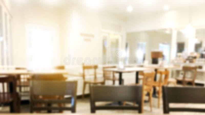 Gör suddig bakgrund för restaurangen eller inre för lagret för efterrättkafé arkivfoto