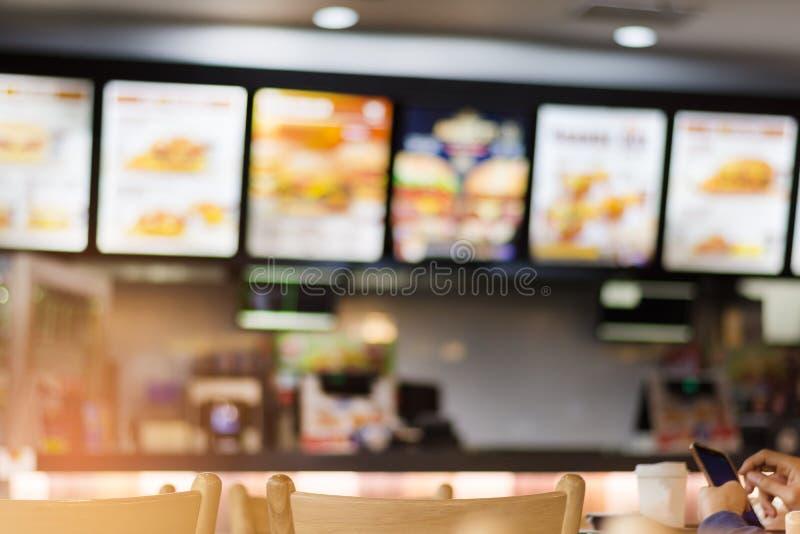 Gör suddig bilden av snabbmatrestaurangen, bruk för defocused bakgrund royaltyfri fotografi