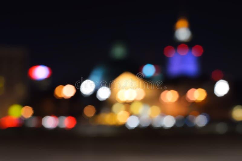 Gör suddig defocused nattljus i en stad, Warszawa arkivbilder