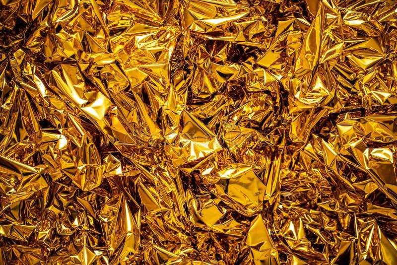 Gör suddig textur av bladguldet, guld- bakgrund royaltyfri fotografi