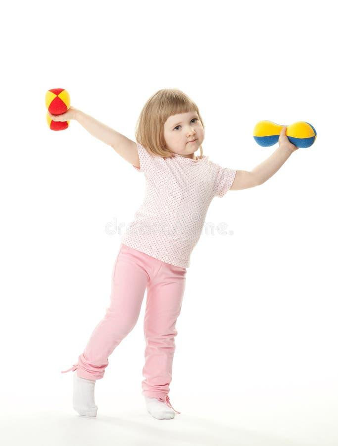 göra övningsflickan little sport royaltyfri foto