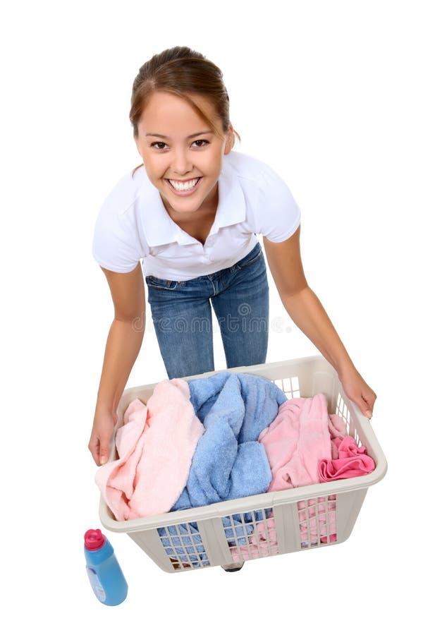 göra den nätt kvinnan för tvätteri fotografering för bildbyråer