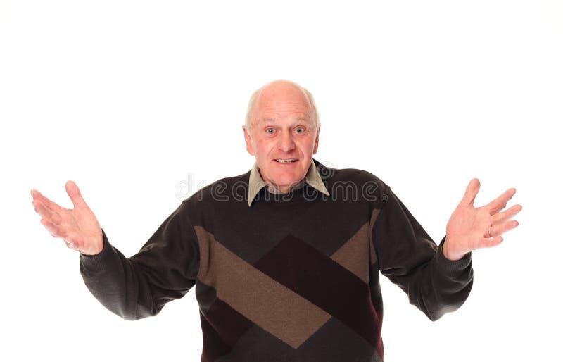 göra en gest äldre pensionär för man arkivbild