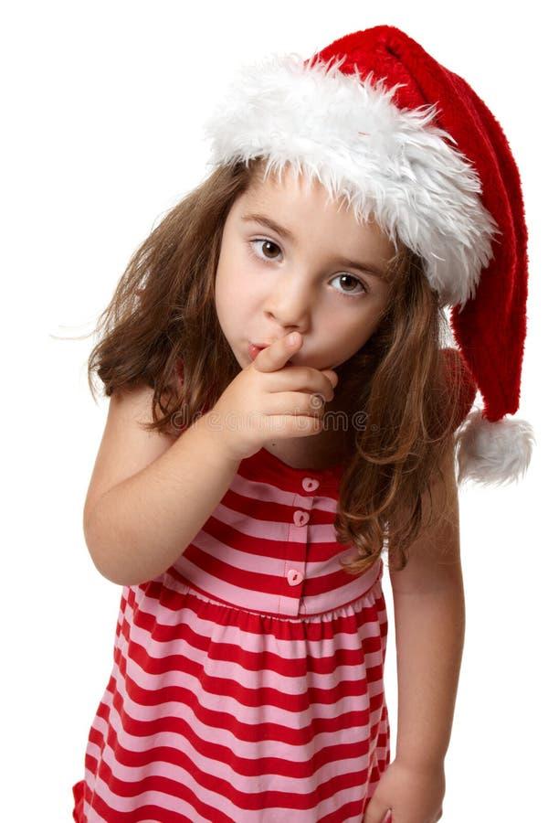 göra en gest flicka som hyssjar tysta santa arkivbilder