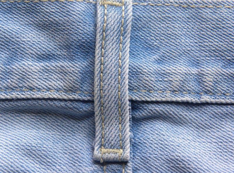 Gürtelschlaufedetail von hellblauen Jeans stockfotografie