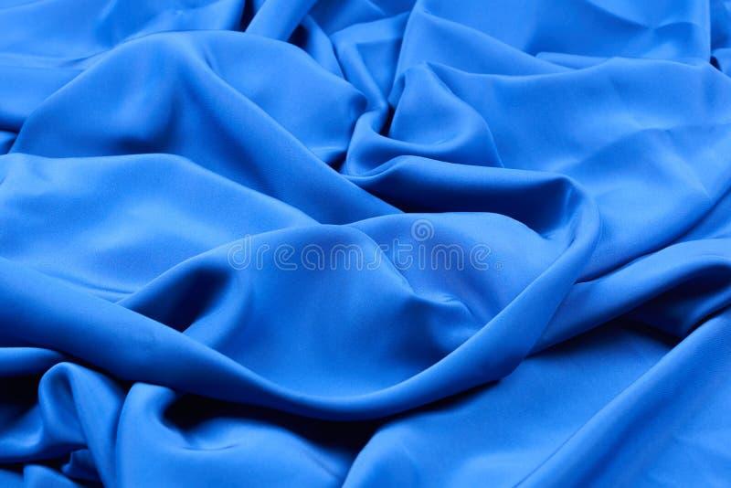 Głęboki błękitny jedwabniczej tkaniny tło zdjęcia royalty free
