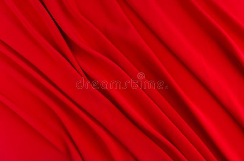 Głęboki - czerwonego jedwabiu gładki tło z kopii przestrzenią Abstrakcjonistyczny pasyjny miłości tło obrazy stock