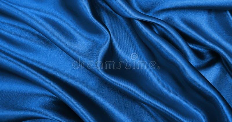 Gładka elegancka błękitna jedwabiu lub atłasu luksusowa sukienna tekstura jako abstra zdjęcie stock
