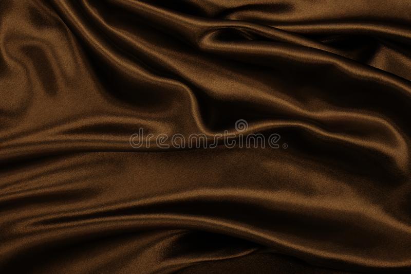 Gładka elegancka brown jedwabiu lub atłasu tekstura jako abstrakcjonistyczny backgroun zdjęcie royalty free