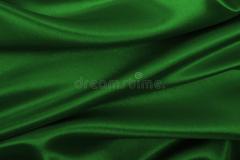 Gładka elegancka zielona jedwabiu lub atłasu luksusowa sukienna tekstura jako abstr zdjęcie royalty free
