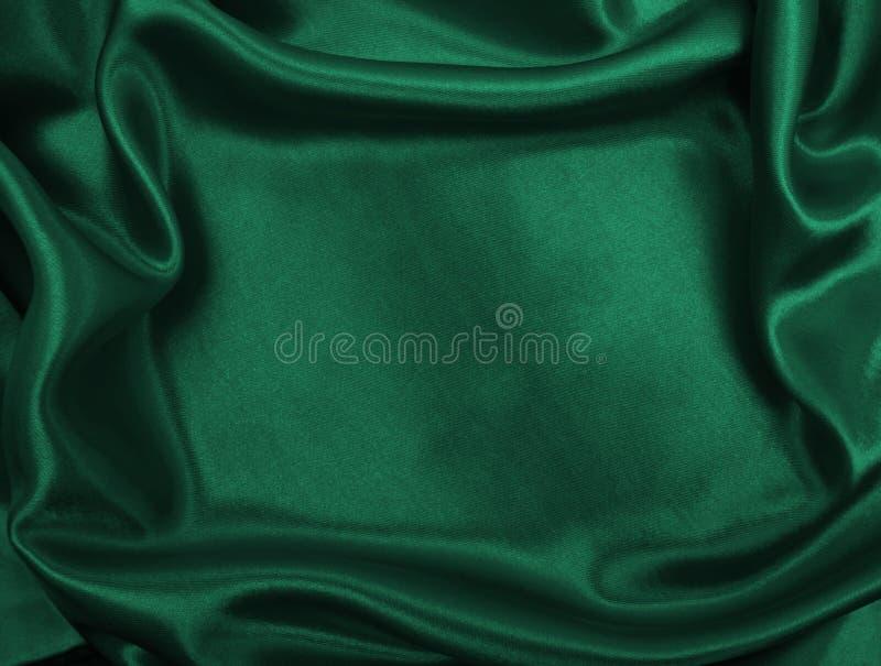 Gładka elegancka zielona jedwabiu lub atłasu luksusowa sukienna tekstura jako abstr obraz stock