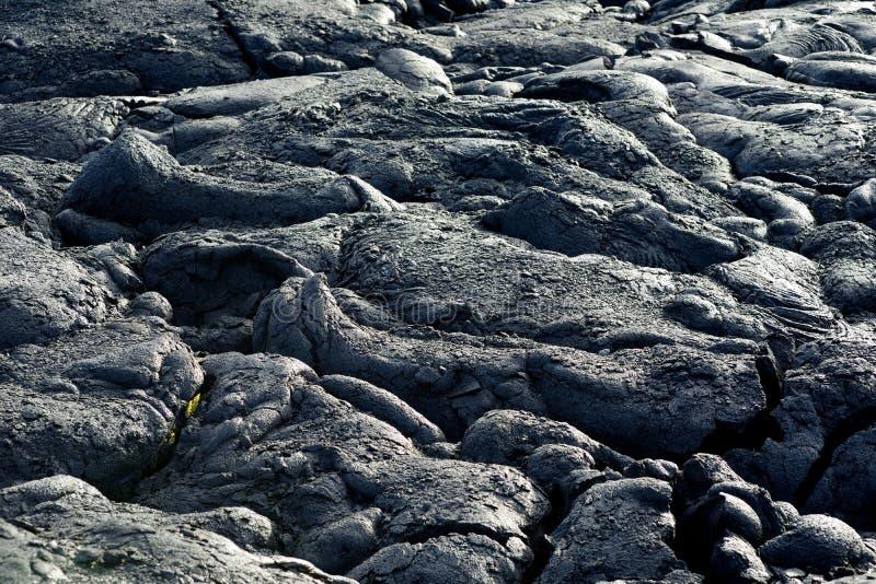 Gładka, pofalowana powierzchnia zamarznięta pahoehoe lawa, Zamarznięta lawa marszcząca wewnątrz jak fałdy i rolki przypomina kręc obraz stock