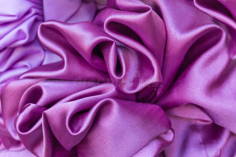 Gładki elegancki purpurowy jedwab może używać jako tło obrazy royalty free
