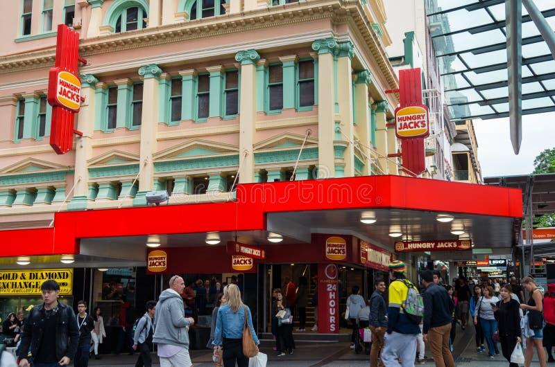 Głodne dźwigarki restauracyjne w środkowym Brisbane obrazy royalty free