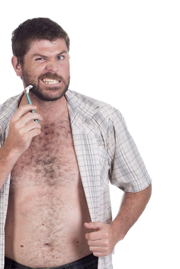 Głuchy mężczyzna z cochlear wszczepu goleniem zdjęcie royalty free