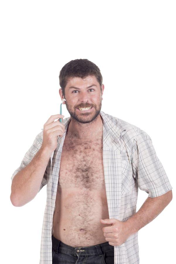 Głuchy mężczyzna z cochlear wszczepu goleniem obrazy royalty free