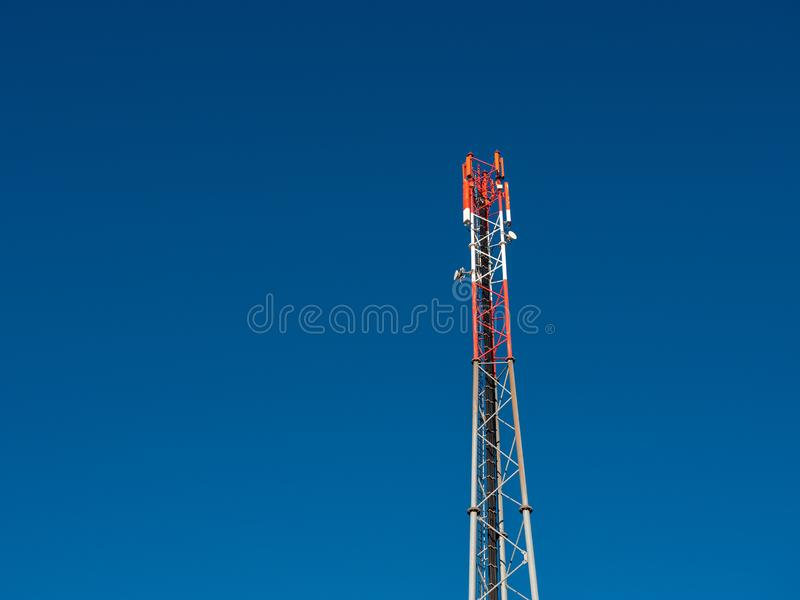 4G or GSM Antenna on a Mobile Telephone Mast. 4G or GSM Antenna on a Red and White Mobile Telephone Mast against a Blue Sky royalty free stock photo