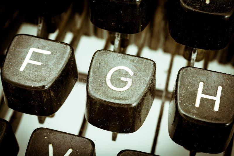 G list na rocznika maszyna do pisania klawiaturze zdjęcie stock