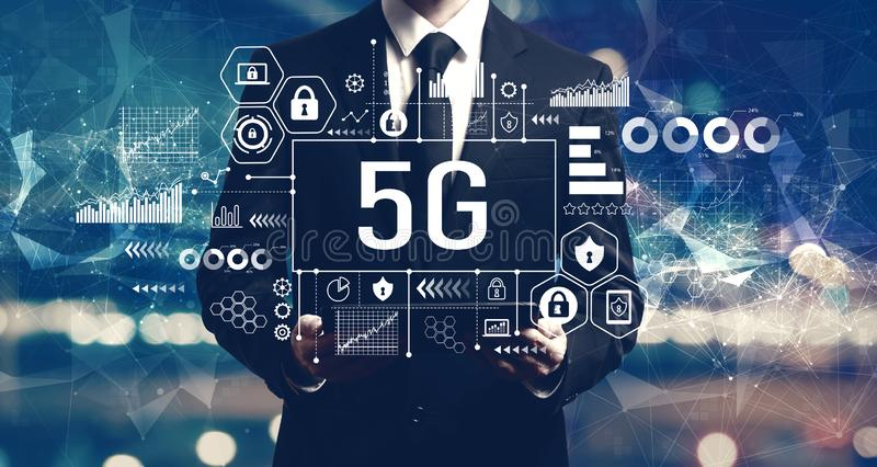 5G network with businessman holding a tablet royalty free stock photos