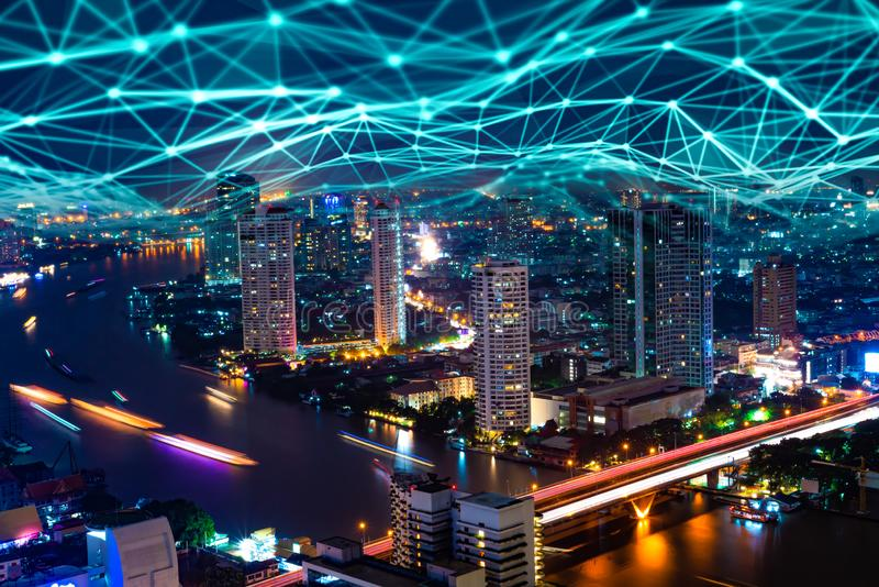 5G network digital hologram and internet of things on city background.5G network wireless systems. royalty free stock photo