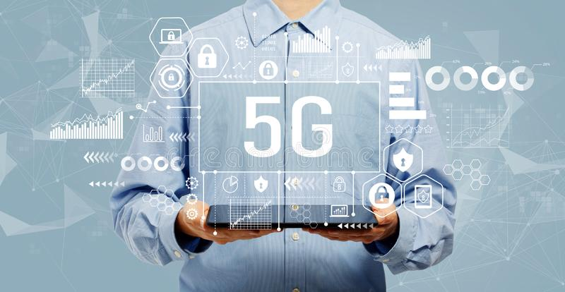 5G network with man holding a tablet royalty free stock photo