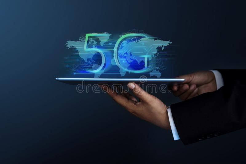 5G Network System Concept. Businessman in Formal Suit Holding a Digital Tablet for Present a New Technology of World Communication stock photography