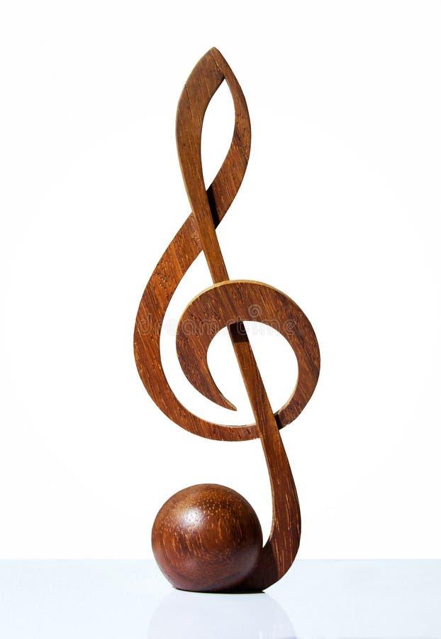 G-Notenschlüsselikone geschnitzt vom Holz stockbilder