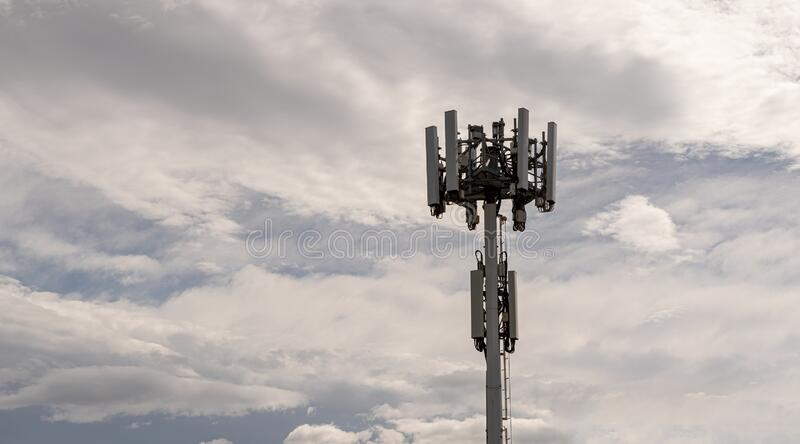 5g phone tower , on a cloudy day stock photo