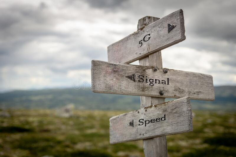 5g, signal and speed words. Engraved on wooden signpost outdoors in nature. Network, satelite and signal concept stock photos