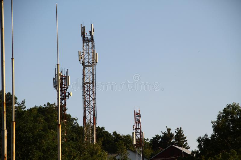 5G smart mobile telephone gsm network antenna base station on the telecommunication mast radiating signal stock photos