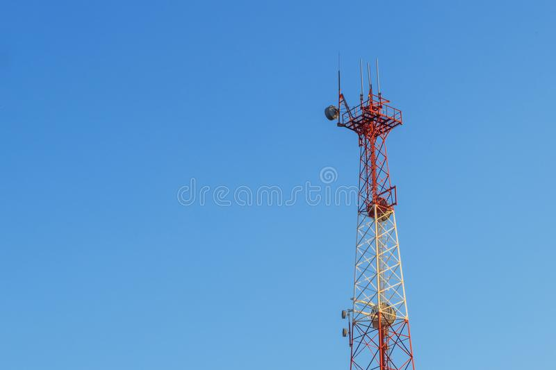 5G smart mobile telephone radio network antenna base station on the telecommunication mast radiating signal.  royalty free stock photo