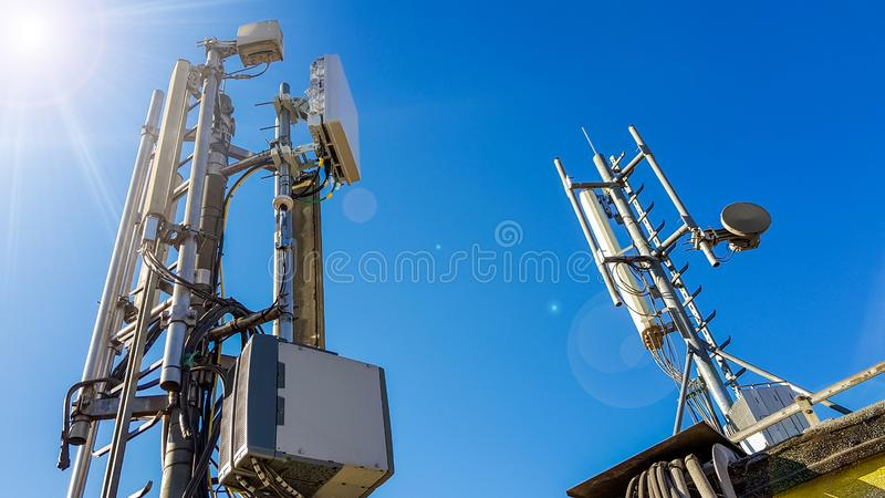 5G smart mobile telephone radio network antenna base station. On the telecommunication mast radiating signal royalty free stock photo