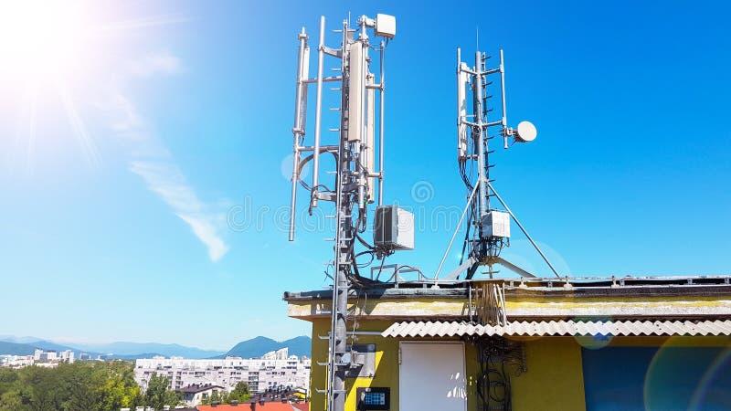 5G smart mobile telephone radio network antenna base station on the telecommunication mast radiating signal. Over the city royalty free stock photos
