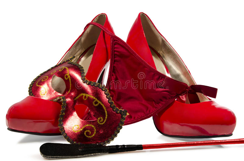 G-string and high heels. G-string, riding crop and high heels close up, on white background stock images
