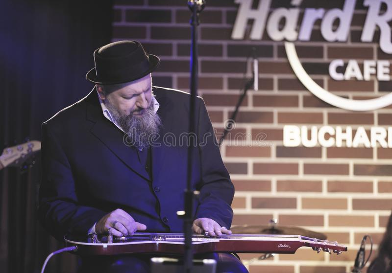 A.G. Weinberger onstage. Musician A.G. Weinberger playing steel guitar onstage at the Hard Rock Cafe in Bucharest, Romania royalty free stock photography